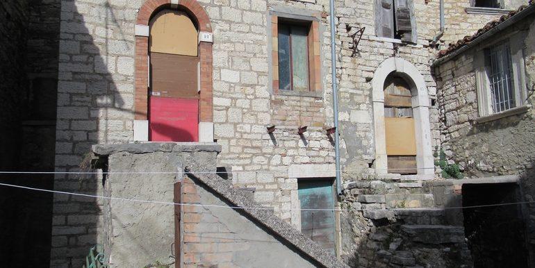 three stone houses
